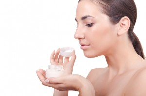 woman holding body cream